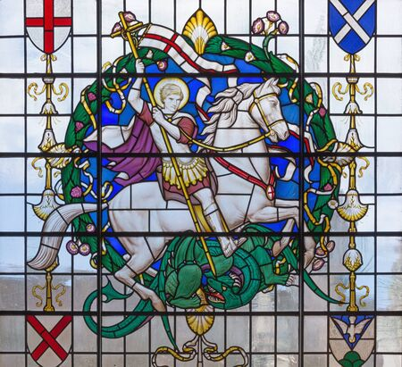 LONDON, GREAT BRITAIN - SEPTEMBER 14, 2017: The saint George on the stained glass in church St. Lawrence Jewry by Christopher Webb (half of 20. cent.)