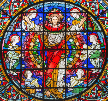 LONDON, GREAT BRITAIN - SEPTEMBER 14, 2017: The resurrected Jesus Christ among the angels on the stained glass in the church St. Michael Cornhill by Clayton and Bell from 19. cent.