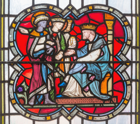LONDON, GREAT BRITAIN - SEPTEMBER 14, 2017: The parable of the talents on the stained glass in the church St. Michael Cornhill by Clayton and Bell from 19. cent. Editorial