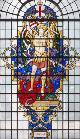 LONDON, GREAT BRITAIN - SEPTEMBER 14, 2017: St. Michael the archangel on the stained glass in church St. Lawrence Jewry by Christopher Webb (half of 20. cent.). Éditoriale