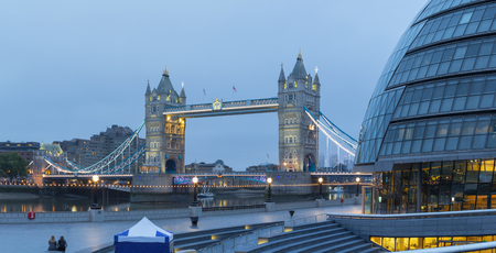 LONDON, GREAT BRITAIN - SEPTEMBER 19, 2017 - The panorama of the Tower bridge, promenade with the the modern Town Hall building at dusk. Editorial