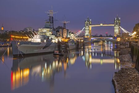 LONDON, GREAT BRITAIN - SEPTEMBER 17, 2017: The panorama of the Tower bridge and cruiser Belfast at dusk. Editorial