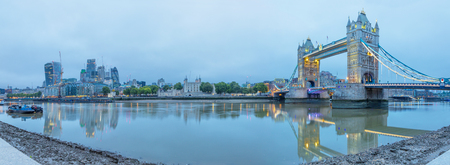 London - The panorama of Tower Bridge, Tower, riverside and skyscrapers in morning dusk.