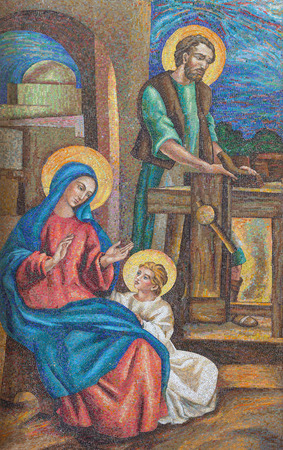 LONDON, GREAT BRITAIN - SEPTEMBER 17, 2017: The detail of the mosaic of Holy Family in St. Peter Italian church from 20. cent. Editorial