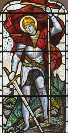 LONDON, GREAT BRITAIN - SEPTEMBER 17, 2017: The St. George on the stained glass in church St. Michael, Chester square. Editorial