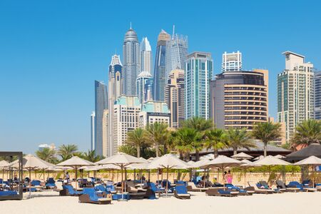 DUBAI, UAE - MARCH 28, 2017: The Marina towers from beach. Editorial