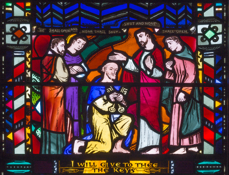 LONDON, GREAT BRITAIN - SEPTEMBER 16, 2017: The Christ Handing the Keys to St Peter on the stained glass in church St Etheldreda by Charles Blakeman (1953 - 1953).