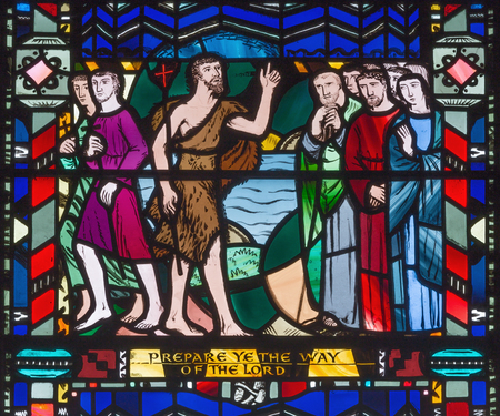 LONDON, GREAT BRITAIN - SEPTEMBER 16, 2017: The Sermon of St. John the Baptist on the stained glass in church St Etheldreda by Charles Blakeman (1953 - 1953).