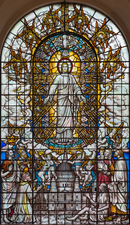 LONDON, GREAT BRITAIN - SEPTEMBER 16, 2017: The resurrected Jesus with the saints and St. Pausl cathedral on the stained glass in St Clement Danes from 20. cent. Editorial