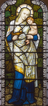 LONDON, GREAT BRITAIN - SEPTEMBER 17, 2017: The symbolic cardinal virtue of Love on the stained glass in church St. Michael, Chester square.