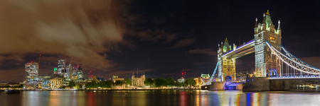 London - The nightly panorama with the Tower bridge, Tower and skyscrapers of financial discrict.