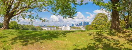 London - The panorama of the Canary Wharf and the City from Greenwich park. Stock Photo