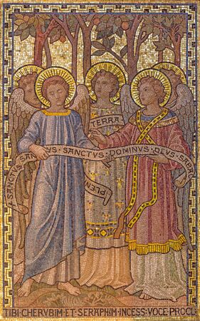 LONDON, GREAT BRITAIN - SEPTEMBER 19, 2017:  The mosaic of angels with the inscription in church St. Mary Abbots by Salviati from Venice (1882). Editorial