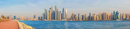 Dubai - The evening panorama of Marina towers and the promenade of Palm Island. Stock Photo