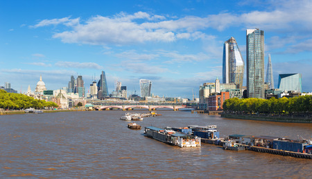 London - The panorama of the City with the skyscraper in the center, St. Paul cathedral and Canary Wharf in the background. Stock Photo