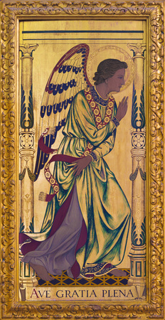LONDON, GREAT BRITAIN - SEPTEMBER 14, 2017: The archangel Gabriel as the left part of Annunciation painting on the wood  on the altar in church St Clements, Eastcheap by Ninian Comper (1933).