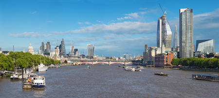 London - The panoramha of the City with the skyscraper in the center, St. Paul cathedral and Canary Warf in the background.
