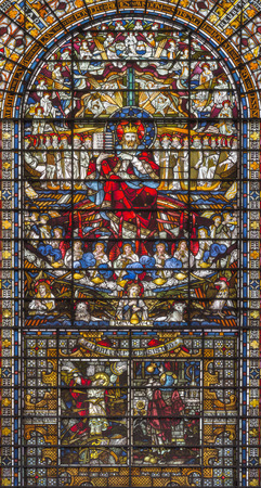 LONDON, GREAT BRITAIN - SEPTEMBER 14, 2017: The Jesus Christ the King on the stained glass in the church St. Edmund the King from 19. cent. Editorial