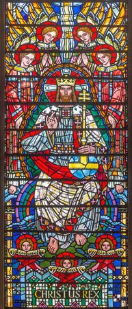 LONDON, GREAT BRITAIN - SEPTEMBER 16, 2017: The stained glass of Jesus Christ the Pantokrator in church St Etheldreda by Joseph Edward Nuttgens (1952). Editorial