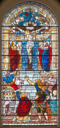 LONDON, GREAT BRITAIN - SEPTEMBER 18, 2017: The Crucifixion of Jesus on the stained glass in the church St Botolph without Bishopsgate by Frank Mody and designed by Nicola Kantorowicz (1992 - 1993).