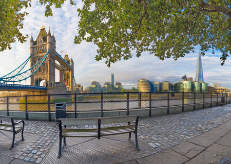 London - The panorama of Thames riverside, Tower bridge and Shard from promenade in morning light. Stock Photo