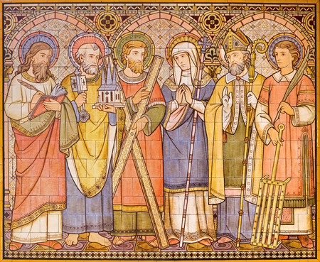 LONDON, GREAT BRITAIN - SEPTEMBER 15, 2017: The tiled mosaic of Apostles and saints in church All Saints designed by Butterfield and painted by Alexander Gibbs (1873). Editorial