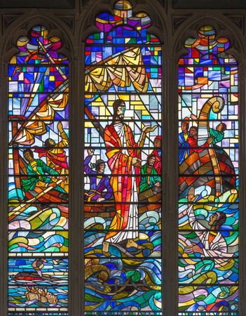 LONDON, GREAT BRITAIN - SEPTEMBER 14, 2017: The Christ helping Peter in the sea storm on the stained glass in the church St. Catharine Cree by Bill Forbes from 21. cent.