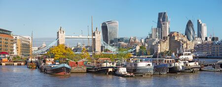 London - The panorama with the Tower Bride, ships and skyscrapers in the morning. Stock Photo