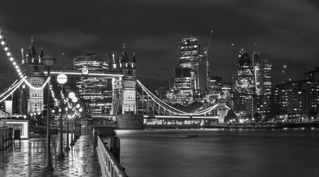 London - The Tower Bridge, promenade and skyscrapers at dusk.