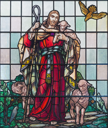LONDON, GREAT BRITAIN - SEPTEMBER 15, 2017: The Jesus as The Good Shepherd on the satined glass of St James's Church, Clerkenwell (1938).