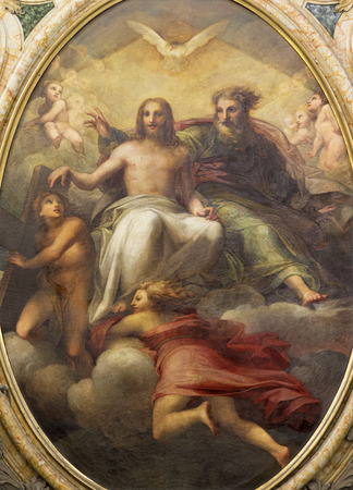 PARMA, ITALY - APRIL 17, 2018: The painting of Holy Trinity on tha main altar in church Chiesa di Santa Teresa by Antonio Ilarioli from 19. cent. Editorial