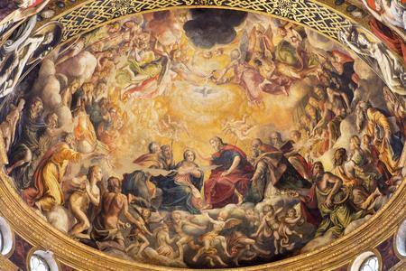 PARMA, ITALY - APRIL 16, 2018: The fresco of Coronation of Virgin Mary in main apse of church Chiesa di Santa Mari della Steccata by Michelangelo Anselmi (1541).