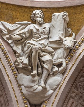 REGGIO EMILIA, ITALY - APRIL 12, 2018: The relief of St. Luke the Evangelist in Duomo church.