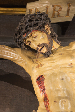 ZARAGOZA, SPAIN - MARCH 2, 2018: The detail of statue of Crucifixion in church  in church Iglesia de la Exaltación de la Santa Cruz. Editorial