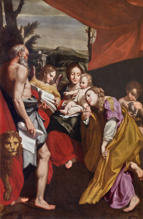 PARMA, ITALY - APRIL 16, 2018: The painting of Madonna with the Child St. Jerome and St. Mary Magdalen in church Chiesa di San Vitale as copy of Correggio (1528). Editorial
