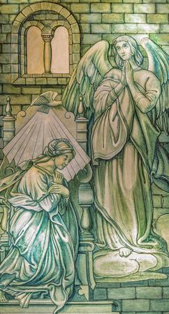 ZARAGOZA, SPAIN - MARCH 3, 2018: The  Annunciation on the stained glass in former church Iglesia del Sagrado Corazon de Jesus.