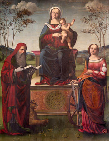 REGGIO EMILIA, ITALY - APRIL 12, 2018: The painting of Madonna on the trone with the Child and st. Jerome and st. Catherine in Dome by Luigi Anguissola from 16. cent.