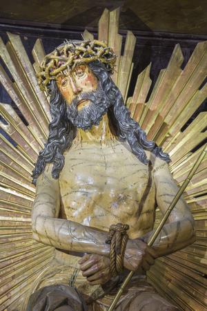 ZARAGOZA, SPAIN - MARCH 1, 2018: The statue of tortured (Ecce Homo) Jesus in church Iglesia de San Felipe y Santiago el Menor by unknown artist.