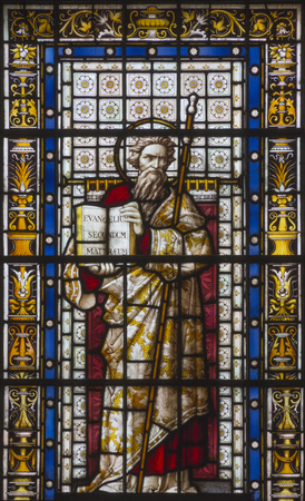 LONDON, GREAT BRITAIN - SEPTEMBER 20, 2017: The St. Matthew the Evangelist on the stained glass in church St. Pancras from 19. cent.