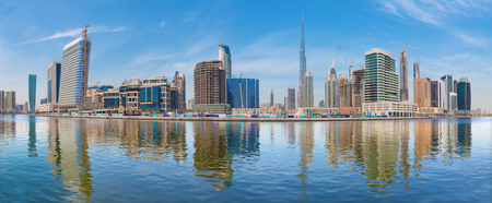 Dubai - The panorama with the new Canal and skyscrapers of Downtown.
