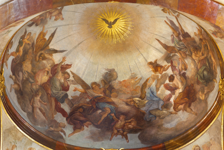 PRAGUE, CZECH REPUBLIC - OCTOBER 12, 2018: The ceiling fresco of Holy Spirit among the angels in St. Francis of Assisi church by Jan KryÅ¡tof LiÅ¡ka (1650 - 1712). Sajtókép