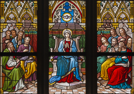 PRAGUE, CZECH REPUBLIC - OCTOBER 12, 2018: The Pentecost on the windowpane in church Bazilika svatého Petra a Pavla na Vyšehrade by František Sequens end. of 19. cent.