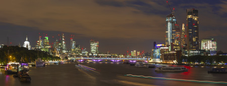 London - The evening panorama of the City with the skyscrapers in the center and Canary Wharf in the background.