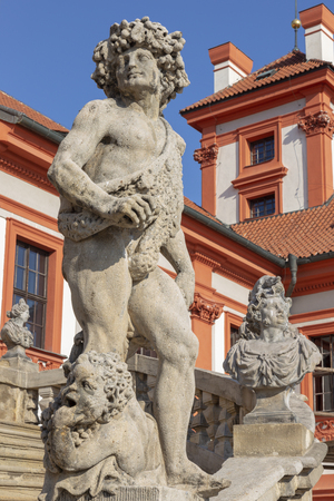 PRAGUE, CZECH REPUBLIC - OCTOBER 16, 2018: The statue of Dionysus on the stairs of baroque palace Trojsky zámek by  Georg a Paul Heermann (1685).