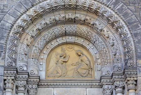 PRAGUE, CZECH REPUBLIC - OCTOBER 17, 2018: The relief of Annunciation on the portal of the church kostel Svatého Cyrila Metodeje by Václav Levý (1867 - 1869)