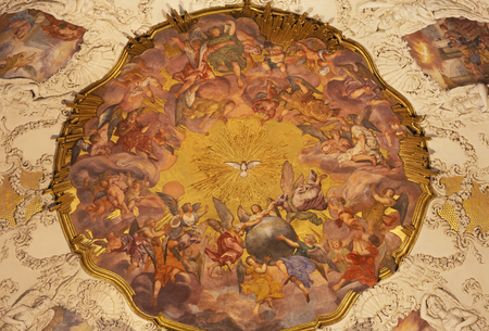 PRAGUE, CZECH REPUBLIC - OCTOBER 18, 2018: The baroque fresco of Angels with the Holy Spirit in church kostel Svaté Voršily by Jan Jakub Stevens ze Steinfelsu (1707). Editorial