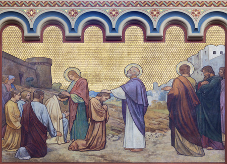 PRAGUE, CZECH REPUBLIC - OCTOBER 17, 2018: The fresco Apostles Peter and John heal in Jerusalem in the church kostel Svatého Cyrila Metodeje by S. G. Rudl (1896). Editorial