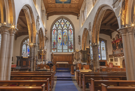 LONDON, GREAT BRITAIN - SEPTEMBER 20, 2017: The nave of church St. Olave with the stained glass by A. E. Buss (1953).