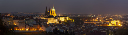 Prague - The panorama of the Town with the Castle and St. Vitus cathedral at dusk. Editorial
