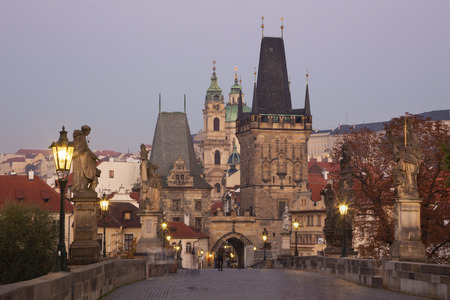 Prague - The Castle and Cathedral and st. Nicholas church from Charles Bridge in the morning dusk. Editorial
